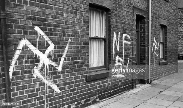Graffiti Swastikas and National Front signs painted on houses and a public house in Durham Road Gateshead Tyne and Wear England in the early hours of...