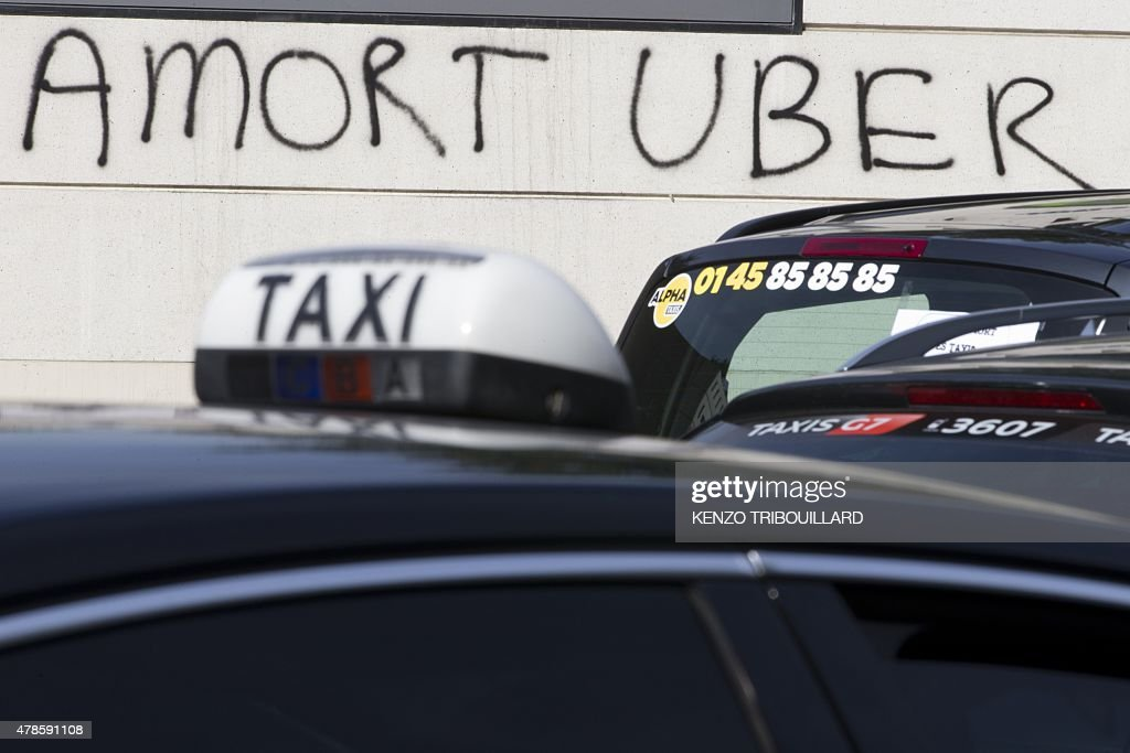 Graffiti That Reads Death To Uber As Taxi Vehicles Block Porte - Taxi porte maillot