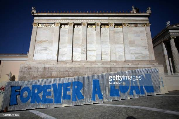 Graffiti that reads Forever a Loan in Athens city center, Greece, September 7, 2017.