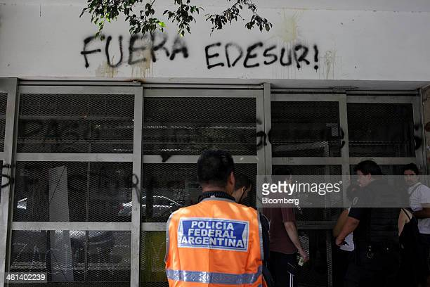 Graffiti that reads 'Get Out Edesur' is painted on Empresa Distribuidora Sur SA offices in the Almagro neighborhood of Buenos Aires Argentina on...