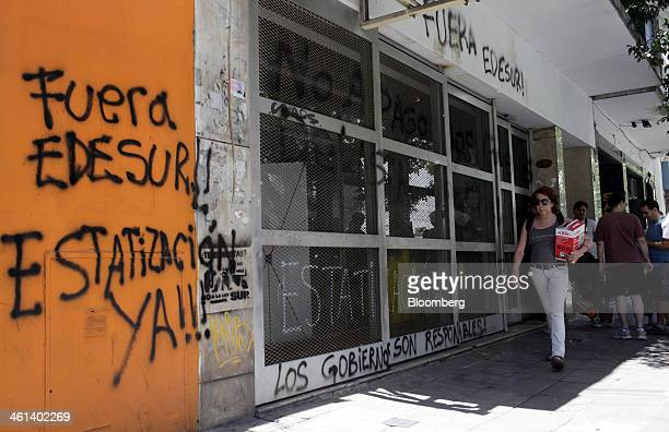 Graffiti that reads 'Get Out Edesur Nationalization now' is painted on Empresa Distribuidora Sur SA offices in the Almagro neighborhood of Buenos...
