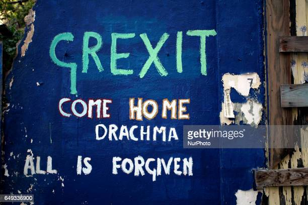 Graffiti that reads Grexit come home drachma all is forgiven in Athens Greece March 7 2017