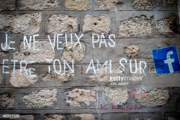 Graffiti that reads in French 'I do not want to be your friend on Facebook' is daubed on a wall in Paris on January 27 2015 AFP PHOTO / JOEL SAGET