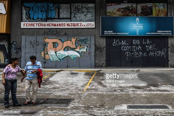 A graffiti that says Which food will the poor eat is seen on the streets of Caracas The opposition called for a general strike for one day as a...