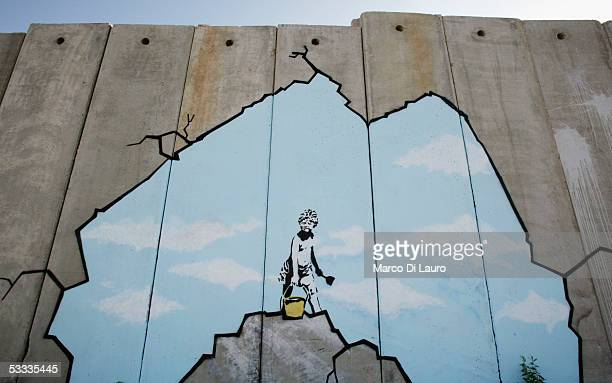 "Graffiti titled ""Art Attack"" made by the British, guerrilla, graffiti artist Banksy is seen on Israel's highly controversial West Bank barrier in..."