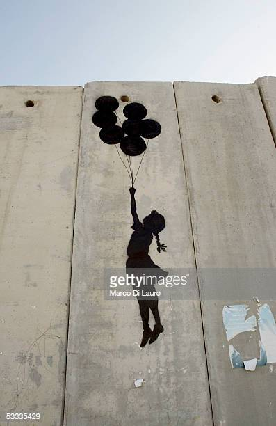 """Graffiti titled """"Balloon Debate"""" made by the British guerrilla, graffiti artist Banksy, is seen on August 6, 2005 on Israel's highly controversial..."""
