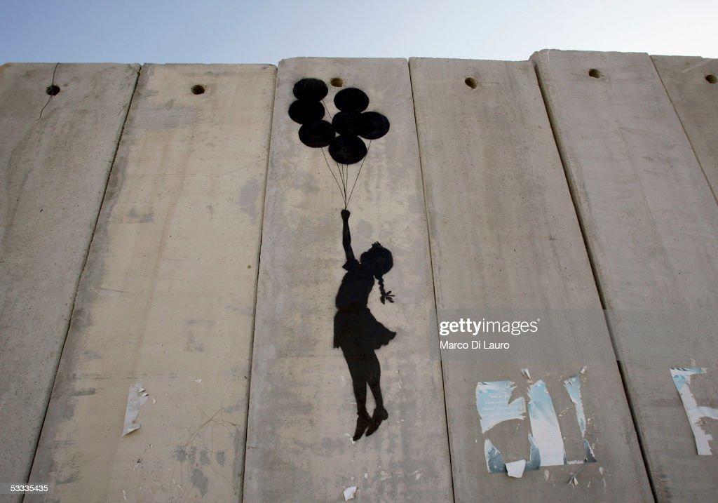 British Guerrilla Artist Decorates West Bank Barrier : News Photo