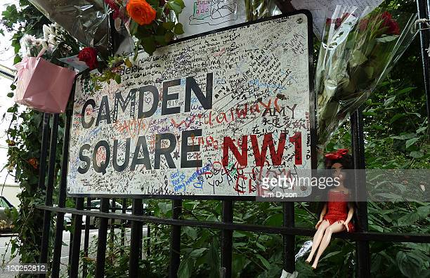Graffiti tributes and a doll are left outside the home of Amy Winehouse in Camden Square, on August 2, 2011 in London, England. Singer Winehouse was...