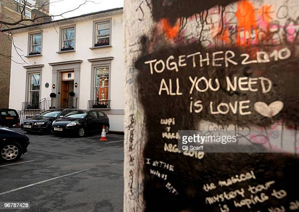 Graffiti tributes written by members of the public cover the entrance to the Abbey Road recording studios which have been put up for sale by their...