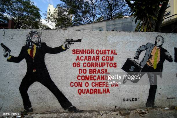 Graffiti with the image of President Michel Temer running with a suitcase of money is seen in the center of Sao Paulo Brazil on 28 August 2018 The...