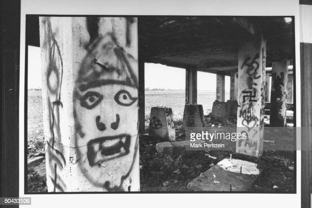 Graffiti written on pillars at abandoned cotton gin where accused murderers, Michael Damien Wayne Echols, Jessie Lloyd Misskelley Jr. & Charles Jason...