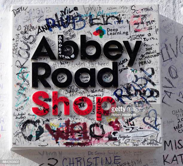A graffiticovered sign in front of Abby Road Shop near Abbey Road Studios in London England formerly known as EMI Studios The recording studio was...