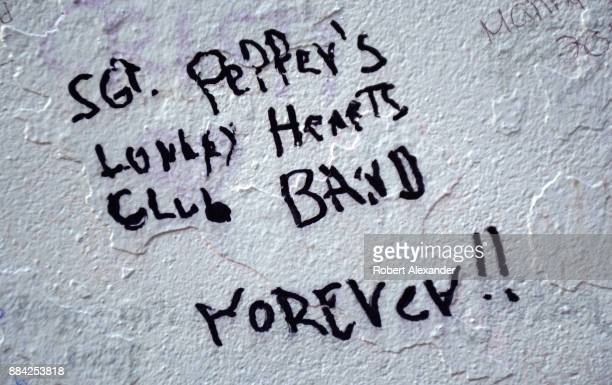 A graffiticovered wall near Abbey Road Studios in London England formerly known as EMI Studios The recording studio was established in 1931 by the...