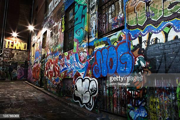 Graffiti/street art site at night, Hosier Lane area.