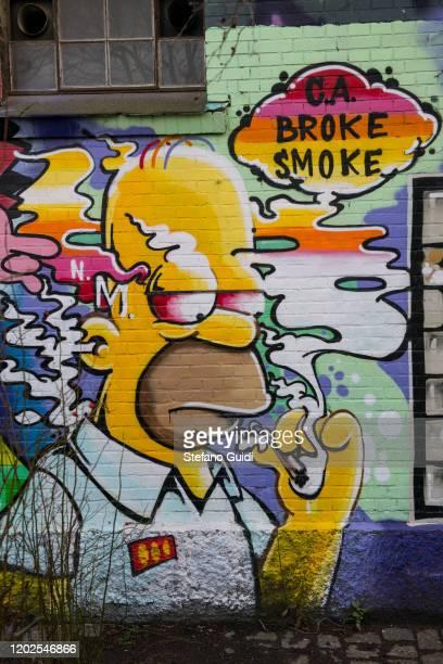 Graffito art depicting Homer Simpson under marijuana effect on Daily Life at Christiania Hippie Community Inside The City Of Copenhagen on January 25...