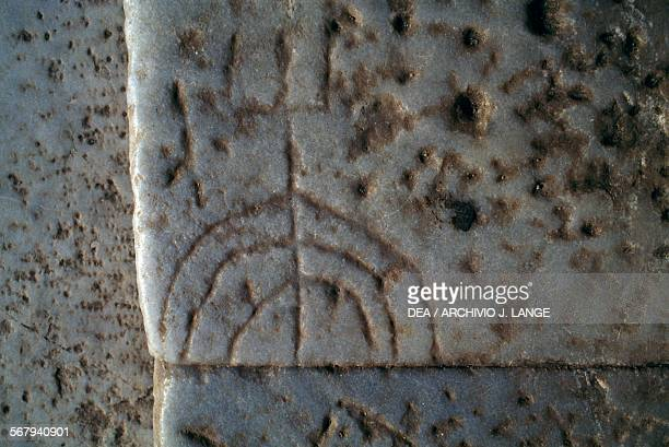 Graffito of a menorah on one of the steps of Celsus Library Ephesus Turkey Roman civilisation 2nd century AD Detail