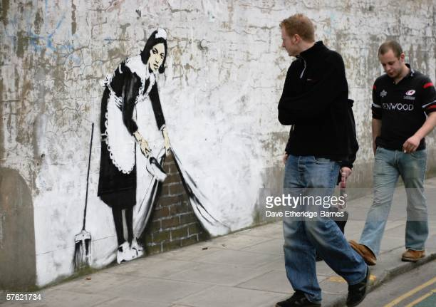 Graffitti art by the 'guerilla' artist Banksy is seen on May 16 2006 in Chalk Farm London The striking large scale spraypainted image entitled...