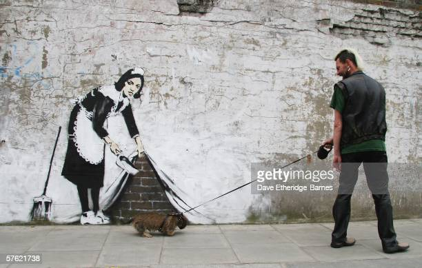 Graffitti art by the 'guerilla' artist Banksy is seen on May 16, 2006 in Chalk Farm, London. The striking large scale spray-painted image entitled...