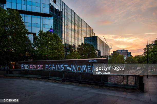 Graffitti protesting against domestic violence increase during the coronavirus pandemic outside UCH on the 10th May 2020 in London United Kingdom...