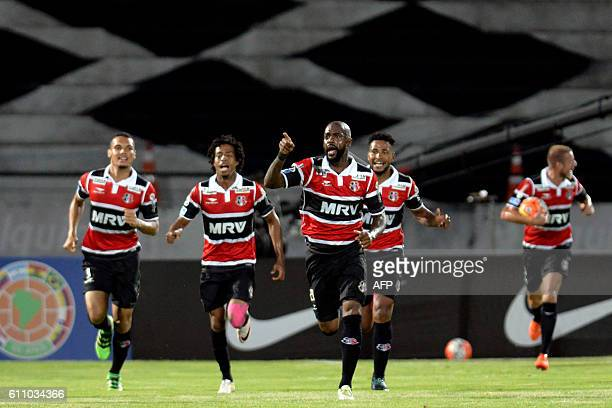 Grafite of Brazil's Santa Cruz celebrates after scoring against Colombia's Independiente Medellin during their Sudamericana Cup football match in...