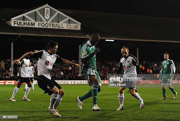Grafite of VfL Wolfsburg is watched by Simon Davies and Danny Murphy of Fulham during the UEFA Europa League quarter final first leg match between...