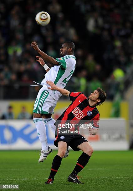Grafite of Wolfsburg and Arne Friedrich of Berlin jump for a header during the Bundesliga match between VfL Wolfsburg and Hertha BSC Berlin at...