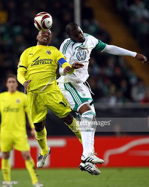 Grafite of Wolfsburg and Marcos Senna of Villareal head for the ball during the UEFA Europa League knockout round second leg match between VfL...