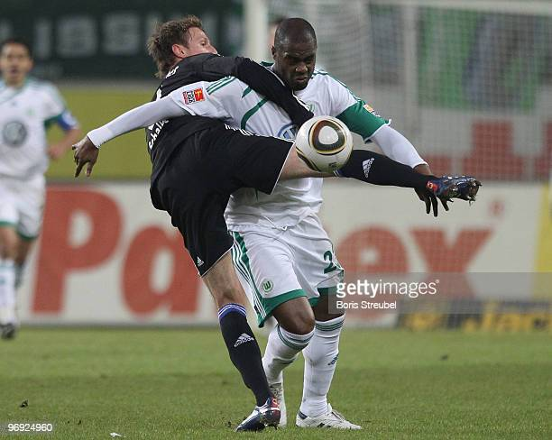 Grafite of Wolfsburg battles for the ball with Benedikt Hoewedes of Schalke during the Bundesliga match between VfL Wolfsburg and FC Schalke 04 at...