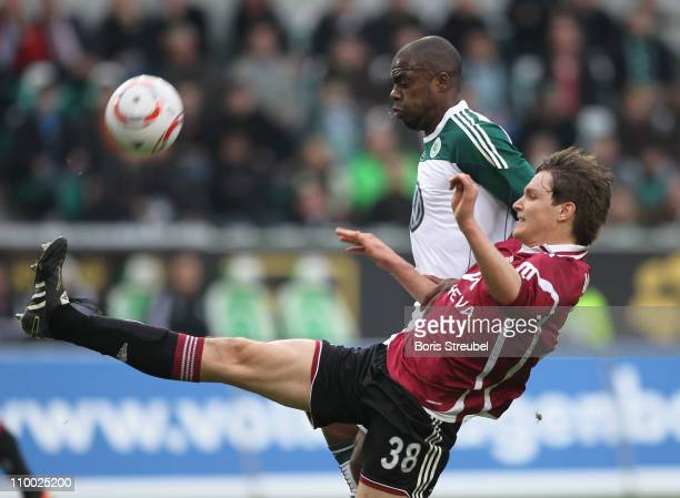 Grafite of Wolfsburg battles for the ball with Philipp Wollscheid of Nuernberg during the Bundesliga match between VfL Wolfsburg and 1 FC Nuernberg...