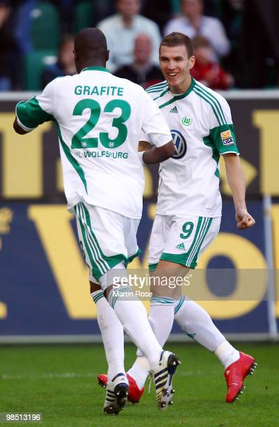 Grafite of Wolfsburg celebrates after scoring his team's second goal with team mate Edin Dzeko during the Bundesliga match between VfL Wolfsburg and...