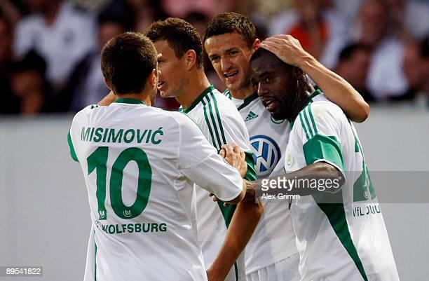 Grafite of Wolfsburg celebrates his team's first goal with team mates Christian Gentner Edin Dzeko and Zvjezdan Misimovic during the DFB Cup first...