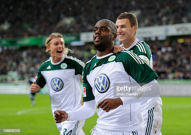 Grafite of Wolfsburg celebrates scoring the first goal with Edin Dzeko during the Bundesliga match between VfL Wolfsburg and FC Schalke 04 at...