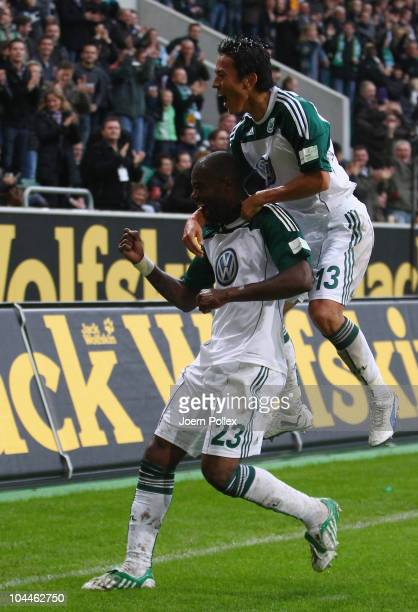 Grafite of Wolfsburg celebrates with his team mate Makoto Hasebe after scoring his team's second goal during the Bundesliga match between VFL...