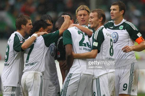 Grafite of Wolfsburg celebrates with his team mates after scoring his team's first goal during the Bundesliga match between VFL Wolfsburg and SC...