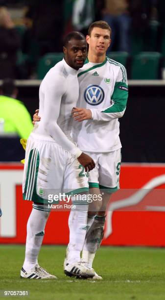 Grafite of Wolfsburg celebrates with team mate Edin Dzeko after the UEFA Europa League knockout round second leg match between VfL Wolfsburg and...