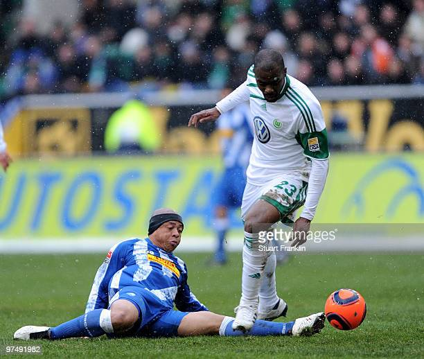 Grafite of Wolfsburg is challenged by Joel Epalle of Bochum during the Bundesliga match between VfL Wolfsburg and VfL Bochum at Volkswagen Arena on...
