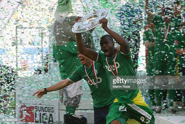 Grafite of Wolfsburg runs with the German Championship trophy after the Bundesliga match between VfL Wolfsburg and Werder Bremen at the Volkswagen...