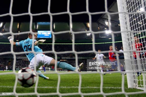 Grafite of Wolfsburg scores his third goal past goalkeeper Igor Akinfeev of Moscow during the UEFA Champions League Group B match between VfL...