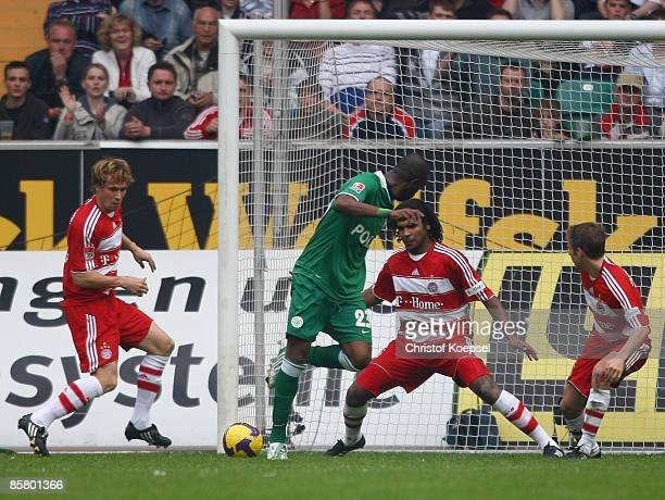 Grafite of Wolfsburg scores the fifth goal against Andreas Ottl Breno and Philipp Lahm of Bayern during the Bundesliga match between VfL Wolfsburg...