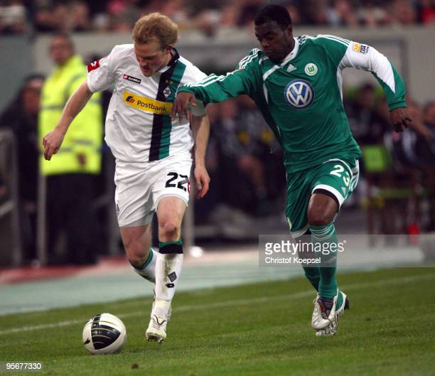 Grafite of Wolfsburg tackles Tobias Levels of Moenchengladbach during the Wintercup match between Borussia Moenchengladbach and VfL Wolfsburg at the...