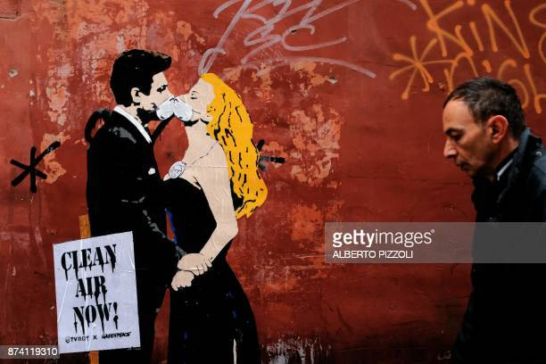 TOPSHOT A grafiti by street artist TVBoy shows a scene of famous Italian movie 'La Dolce Vita' with actors Marcello Mastroianni and Anita Ekberg on...