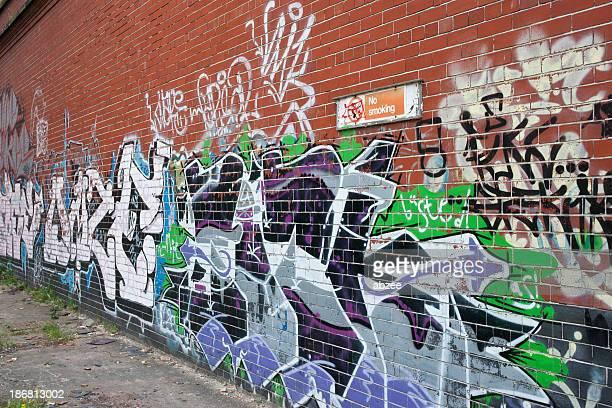 Grafitti covered wall at an angle