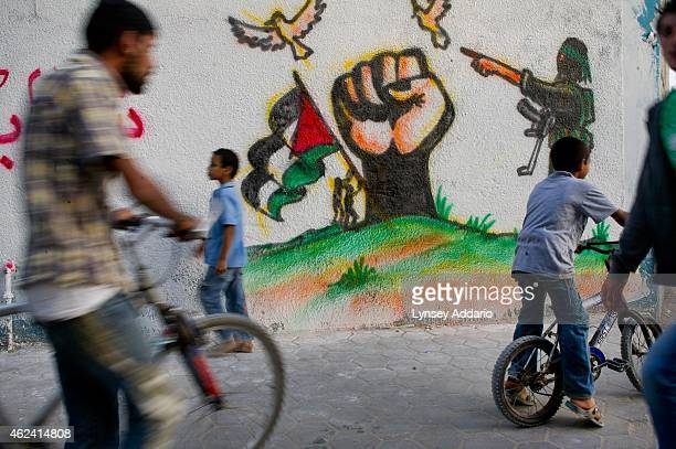 Grafitti lines the streets of Gaza as Hamas prime minister Haniya greets recently returned prisoners in Central Gaza October 21 2011 Since the...