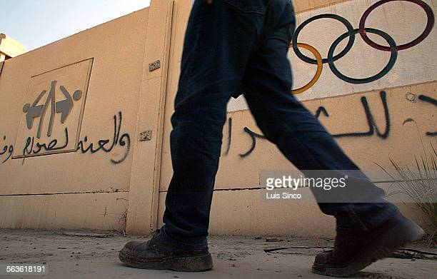 Grafitti scars the outer walls of the burned and looted remains of the Iraqi Olympic Committee headquarters in Baghdad