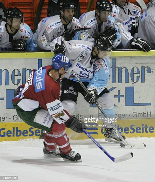 Grag Classen of Hamburg and Shano Joseph of Augsburg during the DEL Bundesliga game between Augsburger Panthers and Hamburg Freezers at the...