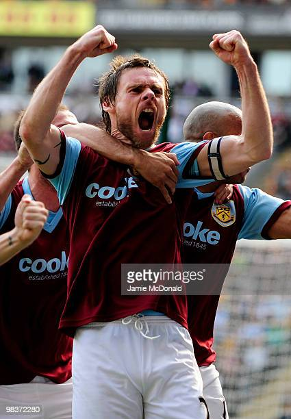 Graham Alexander of Burnley celebrates scoring his team's second goal from a penalty during the Barclays Premier League match between Hull City and...