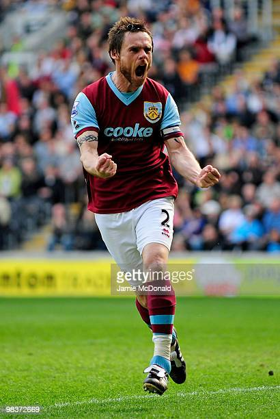Graham Alexander of Burnley celebrates scoring his team's third goal from a penalty during the Barclays Premier League match between Hull City and...
