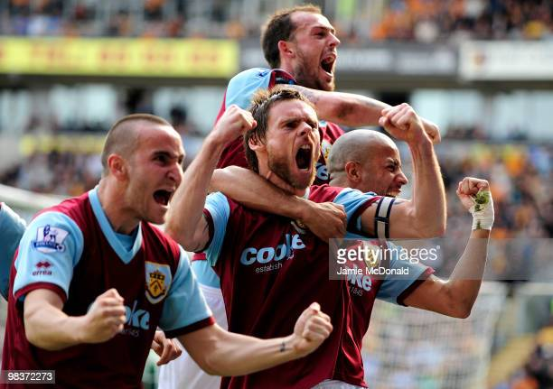 Graham Alexander of Burnley celebrates with his team mates after scoring his team's second goal from a penalty during the Barclays Premier League...