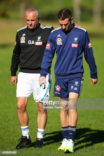 Graham Arnold and Shane Smeltz of Sydney walk to a Sydney FC ALeague training session at Macquarie Uni on June 16 2014 in Sydney Australia