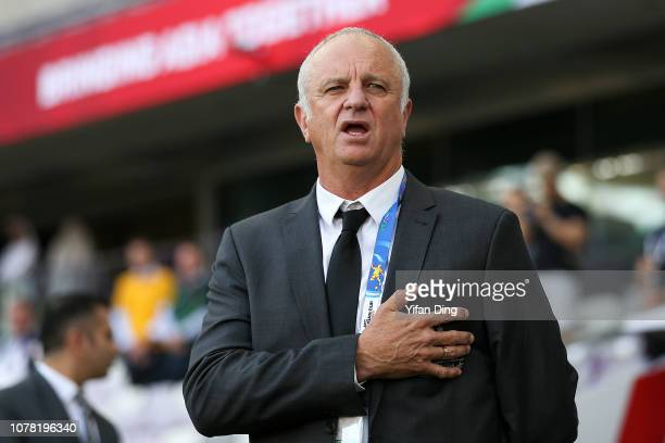 Graham Arnold head coach of Australia sings the national athem prior to the AFC Asian Cup Group B match between Australia and Jordan at Hazza Bin...